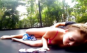 Couple fucks on a trampoline with creampie