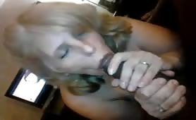 Mature wife sucking a huge black cock