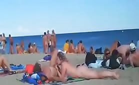 Horny couples fucking on nudist beach