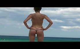sweet topless girl in thong bikini