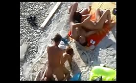 Two couples caught fucking at the beach