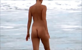 Naked girl in the waves