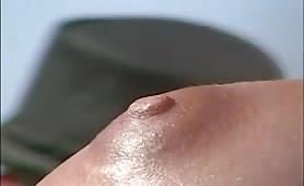 Close up nipples and a bushy cunt