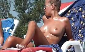 Tanned topless beach babe