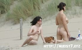 Two naked women on a nudist beach